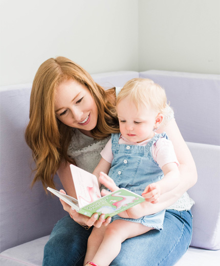 Arielle Gates MA CCC-SLP reading with child